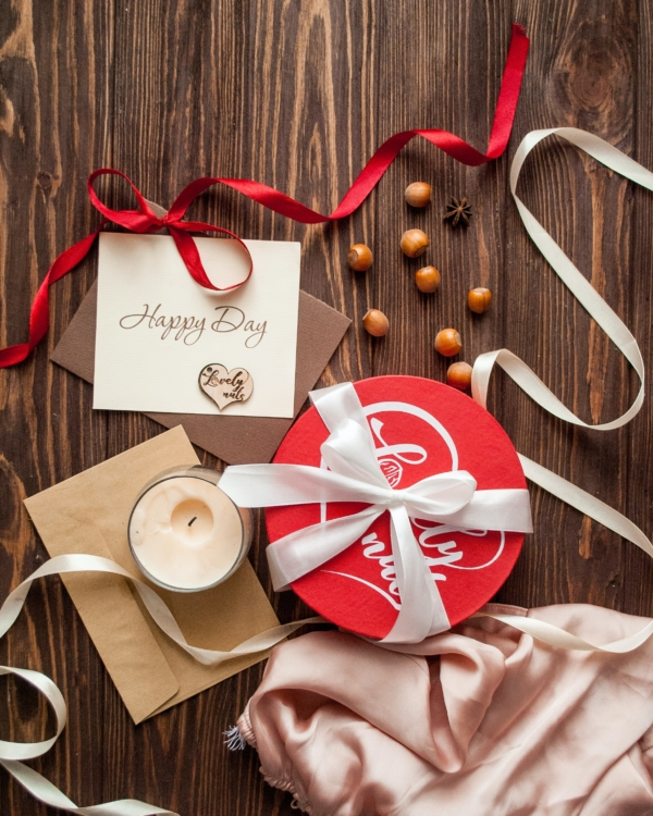 white and red heart print greeting card on brown wooden table